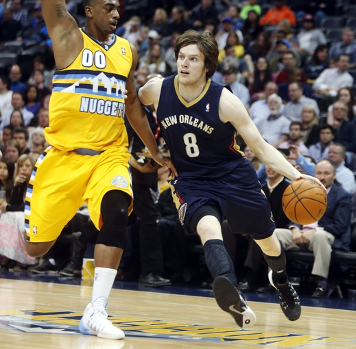 Apr 2, 2014; Denver, CO, USA; New Orleans Pelicans forward Luke Babbitt (8) drives to the basket against Denver Nuggets forward Darrell Arthur (00) during the first half at Pepsi Center. Mandatory Credit: Chris Humphreys-USA TODAY Sports