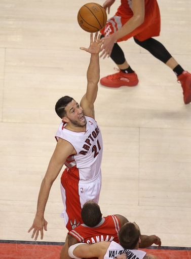 Apr 2, 2014; Toronto, Ontario, CAN; Toronto Raptors guard Greivis Vasquez (21) shoots against the Houston Rockets at Air Canada Centre. The Raptors beat the Rockets 107-103. Mandatory Credit: Tom Szczerbowski-USA TODAY Sports
