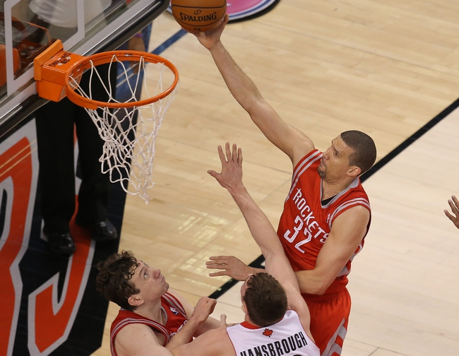 Apr 2, 2014; Toronto, Ontario, CAN; Houston Rockets forward Francisco Garcia (32) goes to the basket and scores against the Toronto Raptors at Air Canada Centre. The Raptors beat the Rockets 107-103. Mandatory Credit: Tom Szczerbowski-USA TODAY Sports