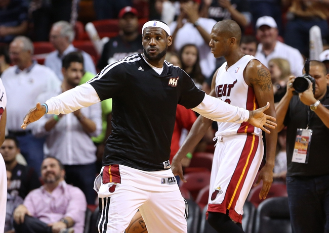 Apr 2, 2014; Miami, FL, USA;  Miami Heat forward LeBron James (6) congratulates teammates after the Heat defeated the Milwaukee Bucks 96-77 at American Airlines Arena.  Mandatory Credit: Robert Mayer-USA TODAY Sports