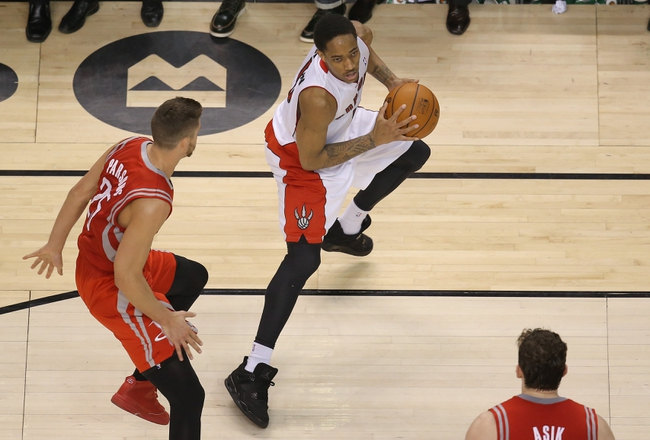 Apr 2, 2014; Toronto, Ontario, CAN; Toronto Raptors guard DeMar DeRozan (10) with the ball against the Houston Rockets at Air Canada Centre. The Raptors beat the Rockets 107-103. Mandatory Credit: Tom Szczerbowski-USA TODAY Sports