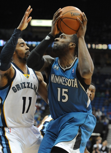 Apr 2, 2014; Minneapolis, MN, USA;  Minnesota Timberwolves forward Shabazz Muhammad (15) looks to shoot over Memphis Grizzlies guard Mike Conley (11) in the fourth quarter at Target Center. The Wolves defeated the Grizzlies 102-88.  Mandatory Credit: Marilyn Indahl-USA TODAY Sports