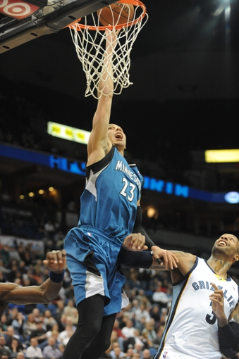Apr 2, 2014; Minneapolis, MN, USA;  Minnesota Timberwolves guard Kevin Martin (23) takes a shot over Memphis Grizzlies forward James Johnson (3) in the fourth quarter at Target Center. The Wolves defeated the Grizzlies 102-88.  Mandatory Credit: Marilyn Indahl-USA TODAY Sports