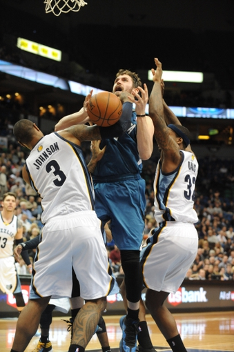 Apr 2, 2014; Minneapolis, MN, USA;  Minnesota Timberwolves forward Kevin Love (42) grabs a rebound along with Memphis Grizzlies forward James Johnson (3)  resulting in a technical foul for each of them in the fourth quarter at Target Center. The Wolves defeated the Grizzlies 102-88.  Mandatory Credit: Marilyn Indahl-USA TODAY Sports