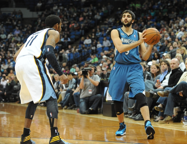 Apr 2, 2014; Minneapolis, MN, USA;  Minnesota Timberwolves guard Ricky Rubio (9) looks to pass over Memphis Grizzlies guard Mike Conley (11) in the fourth quarter at Target Center. The Wolves defeated the Grizzlies 102-88.  Mandatory Credit: Marilyn Indahl-USA TODAY Sports