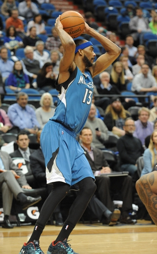 Apr 2, 2014; Minneapolis, MN, USA;  Minnesota Timberwolves forward Corey Brewer (13) looks to pass in the fourth quarter against the Memphis Grizzlies at Target Center. The Wolves defeated the Grizzlies 102-88.  Mandatory Credit: Marilyn Indahl-USA TODAY Sports