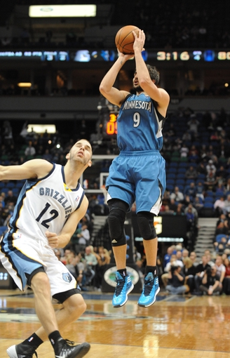 Apr 2, 2014; Minneapolis, MN, USA;  Minnesota Timberwolves guard Ricky Rubio (9) takes a shot in the fourth quarter against the Memphis Grizzlies at Target Center. The Wolves defeated the Grizzlies 102-88.  Mandatory Credit: Marilyn Indahl-USA TODAY Sports