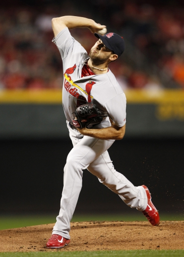 Apr 2, 2014; Cincinnati, OH, USA; St. Louis Cardinals starting pitcher Michael Wacha (52) pitches during the first inning against the Cincinnati Reds at Great American Ball Park. Mandatory Credit: Frank Victores-USA TODAY Sports