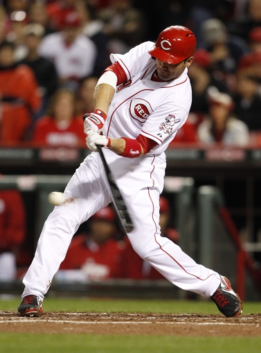 Apr 2, 2014; Cincinnati, OH, USA; Cincinnati Reds first baseman Joey Votto (19) singles during the fourth inning for his 1001st hit against the St. Louis Cardinals at Great American Ball Park. Mandatory Credit: Frank Victores-USA TODAY Sports