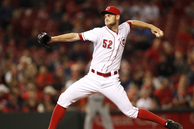 Apr 2, 2014; Cincinnati, OH, USA; Cincinnati Reds starting pitcher Tony Cingrani (52) pitches during the second inning against the St. Louis Cardinals at Great American Ball Park. Mandatory Credit: Frank Victores-USA TODAY Sports