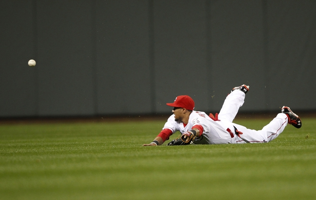 Apr 2, 2014; Cincinnati, OH, USA; Cincinnati Reds center fielder Billy Hamilton (6) dives and misses a ball during the fourth inning against the St. Louis Cardinals at Great American Ball Park. Mandatory Credit: Frank Victores-USA TODAY Sports