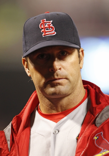 Apr 2, 2014; Cincinnati, OH, USA; St. Louis Cardinals manager Mike Matheny (22) in the dugout during the third inning against the Cincinnati Reds at Great American Ball Park. Mandatory Credit: Frank Victores-USA TODAY Sports