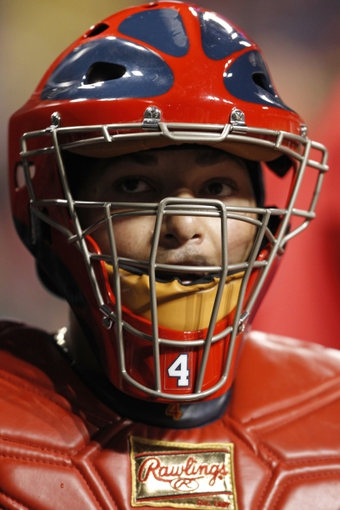 Apr 2, 2014; Cincinnati, OH, USA; St. Louis Cardinals catcher Yadier Molina (4) in the dugout during the third inning against the Cincinnati Reds at Great American Ball Park. Mandatory Credit: Frank Victores-USA TODAY Sports