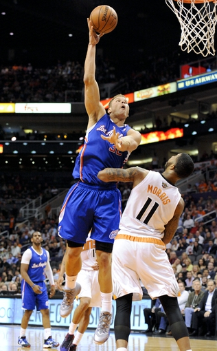 Apr 2, 2014; Phoenix, AZ, USA; Los Angeles Clippers forward Blake Griffin (32) shoots over Phoenix Suns forward Markieff Morris (11) during the second quarter at US Airways Center. Mandatory Credit: Casey Sapio-USA TODAY Sports