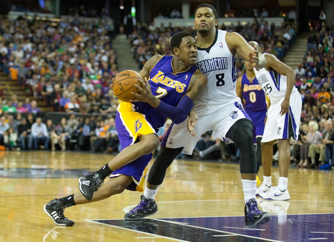 Apr 2, 2014; Sacramento, CA, USA; Los Angeles Lakers guard MarShon Brooks (2) drives in against Sacramento Kings forward Rudy Gay (8) during the second quarter at Sleep Train Arena. Mandatory Credit: Kelley L Cox-USA TODAY Sports