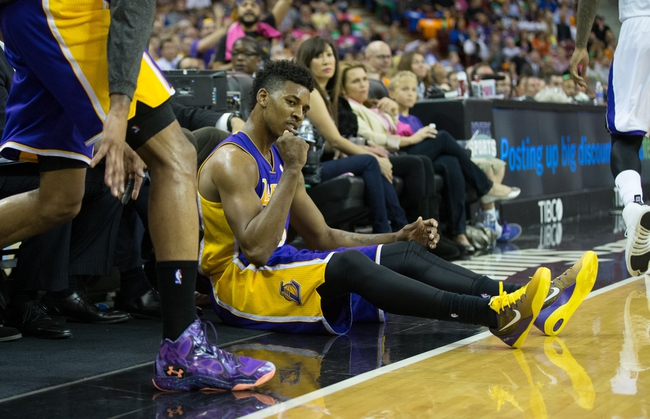 Apr 2, 2014; Sacramento, CA, USA; Los Angeles Lakers forward Nick Young (0) celebrates after a three point basket and foul against the Sacramento Kings during the second quarter at Sleep Train Arena. Mandatory credit: Kelley L Cox-USA TODAY Sports