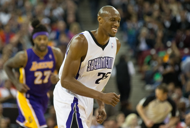 Apr 2, 2014; Sacramento, CA, USA; Sacramento Kings forward Travis Outlaw (25) smiles after scoring a basket as he returns to defense against Los Angeles Lakers forward Jordan Hill (27) during the second quarter at Sleep Train Arena. Mandatory Credit: Kelley L Cox-USA TODAY Sports