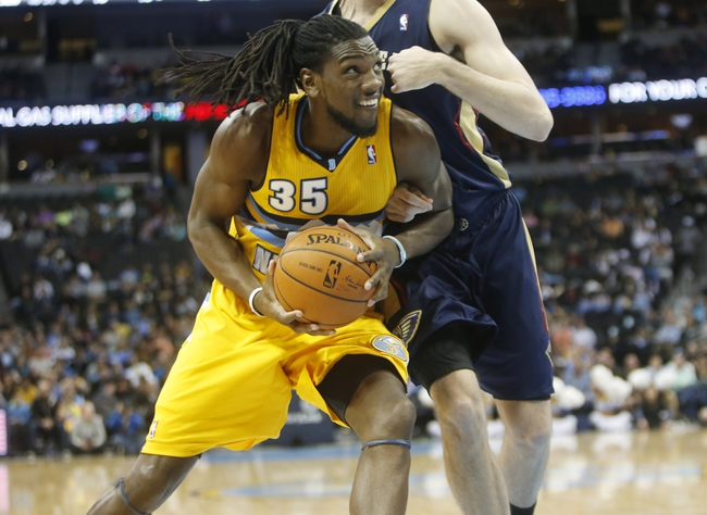 Apr 2, 2014; Denver, CO, USA; Denver Nuggets forward Kenneth Faried (35) drives to the basket during the second half against the New Orleans Pelicans at Pepsi Center.  The Nuggets won 137-107.  Mandatory Credit: Chris Humphreys-USA TODAY Sports