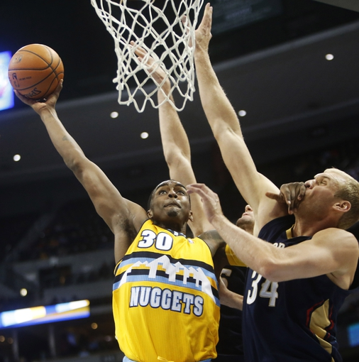 Apr 2, 2014; Denver, CO, USA; Denver Nuggets forward Quincy Miller (30) shoots the ball during the second half against the New Orleans Pelicans at Pepsi Center.  The Nuggets won 137-107.  Mandatory Credit: Chris Humphreys-USA TODAY Sports