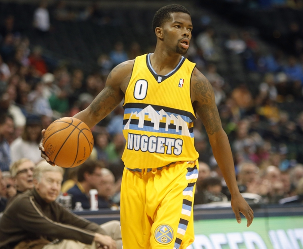 Apr 2, 2014; Denver, CO, USA; Denver Nuggets guard Aaron Brooks (0) with the ball during the second half against the New Orleans Pelicans at Pepsi Center.  The Nuggets won 137-107.  Mandatory Credit: Chris Humphreys-USA TODAY Sports