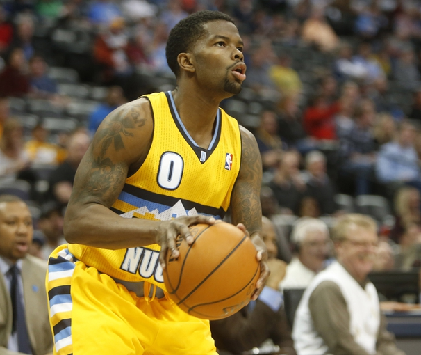 Apr 2, 2014; Denver, CO, USA; Denver Nuggets guard Aaron Brooks (0) gets ready to shoot the ball during the second half against the New Orleans Pelicans at Pepsi Center.  The Nuggets won 137-107.  Mandatory Credit: Chris Humphreys-USA TODAY Sports