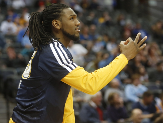 Apr 2, 2014; Denver, CO, USA; Denver Nuggets forward Kenneth Faried (35) reacts from the bench during the second half against the New Orleans Pelicans at Pepsi Center.  The Nuggets won 137-107.  Mandatory Credit: Chris Humphreys-USA TODAY Sports