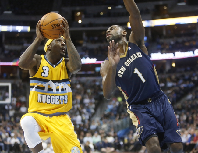 Apr 2, 2014; Denver, CO, USA; Denver Nuggets guard Ty Lawson (3) shoots the ball over New Orleans guard Tyreke Evans (1) during the second half at Pepsi Center.  The Nuggets won 137-107.  Mandatory Credit: Chris Humphreys-USA TODAY Sports