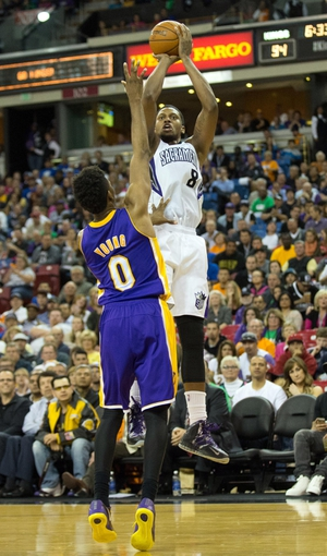 Apr 2, 2014; Sacramento, CA, USA; Sacramento Kings forward Rudy Gay (8) scores a basket against Los Angeles Lakers forward Nick Young (0) during the fourth quarter at Sleep Train Arena. The Sacramento Kings defeated the Los Angeles Lakers 107-102. Mandatory Credit: Kelley L Cox-USA TODAY Sports