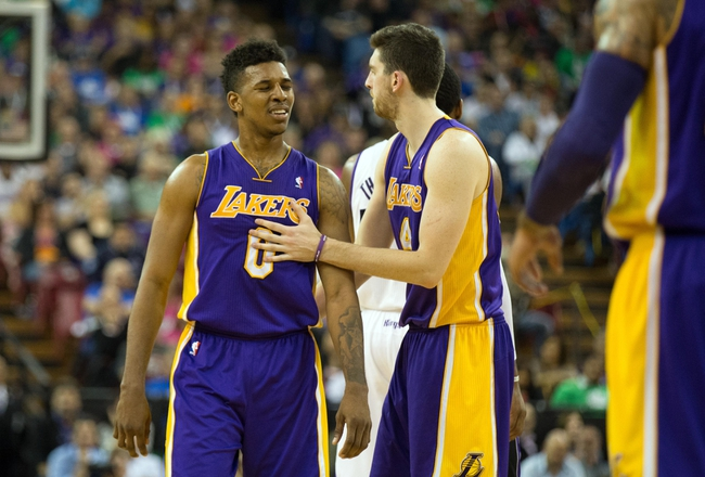 Apr 2, 2014; Sacramento, CA, USA; Los Angeles Lakers forward Nick Young (0) with forward Ryan Kelly (4) after being called for a technical against the Sacramento Kings during the fourth quarter at Sleep Train Arena. The Sacramento Kings defeated the Los Angeles Lakers 107-102. Mandatory Credit: Kelley L Cox-USA TODAY Sports