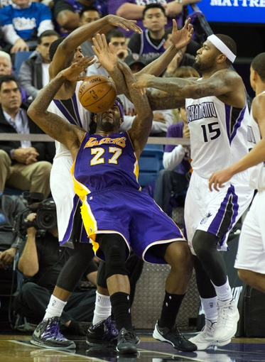 Apr 2, 2014; Sacramento, CA, USA; Sacramento Kings forward Rudy Gay (8) and center DeMarcus Cousins (15) surround Los Angeles Lakers forward Jordan Hill (27) to steal the ball during the fourth quarter at Sleep Train Arena. The Sacramento Kings defeated the Los Angeles Lakers 107-102. Mandatory Credit: Kelley L Cox-USA TODAY Sports