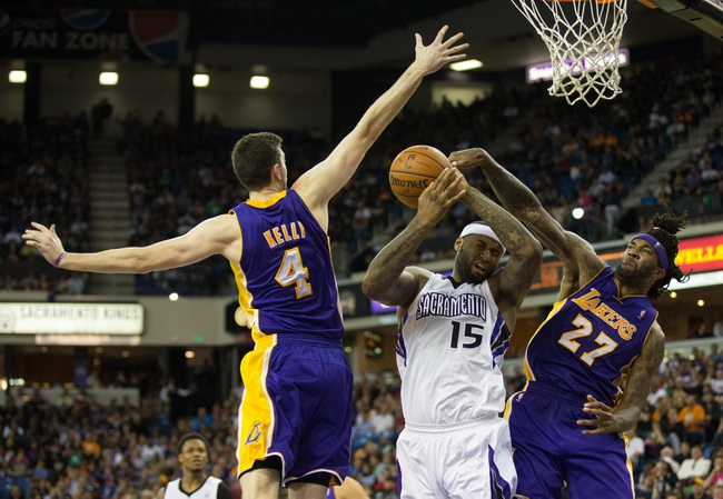 Apr 2, 2014; Sacramento, CA, USA; Sacramento Kings center DeMarcus Cousins (15) battles for the ball between Los Angeles Lakers forward Ryan Kelly (4) and forward Jordan Hill (27) during the fourth quarter at Sleep Train Arena. The Sacramento Kings defeated the Los Angeles Lakers 107-102. Mandatory Credit: Kelley L Cox-USA TODAY Sports
