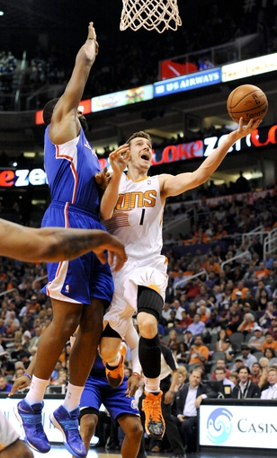 Apr 2, 2014; Phoenix, AZ, USA; Phoenix Suns guard Goran Dragic (1) shoots the ball as he is defended by Los Angeles Clippers center DeAndre Jordan (6) during the third quarter at US Airways Center. The Clippers won 112-108. Mandatory Credit: Casey Sapio-USA TODAY Sports