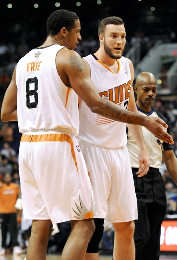 Apr 2, 2014; Phoenix, AZ, USA; Phoenix Suns forward Channing Frye (8) and center Miles Plumlee (22) talk during the third quarter against the Los Angeles Clippers at US Airways Center. The Clippers won 112-108. Mandatory Credit: Casey Sapio-USA TODAY Sports