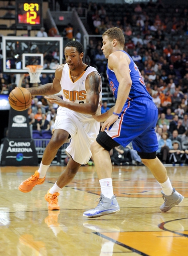 Apr 2, 2014; Phoenix, AZ, USA; Phoenix Suns forward Channing Frye (8) dribbles around Los Angeles Clippers forward Blake Griffin (32) during the third quarter at US Airways Center. The Clippers won 112-108. Mandatory Credit: Casey Sapio-USA TODAY Sports