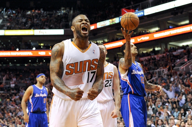 Apr 2, 2014; Phoenix, AZ, USA; Phoenix Suns forward P.J Tucker (17) celebrates during the third quarter against the Los Angeles Clippers at US Airways Center. The Clippers won 112-108. Mandatory Credit: Casey Sapio-USA TODAY Sports