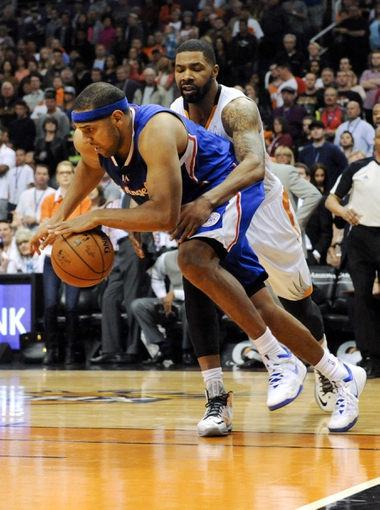 Apr 2, 2014; Phoenix, AZ, USA; Phoenix Suns forward Marcus Morris (15) fouls Los Angeles Clippers forward Jared Dudley (9) during the fourth quarter at US Airways Center. The Clippers won 112-108. Mandatory Credit: Casey Sapio-USA TODAY Sports