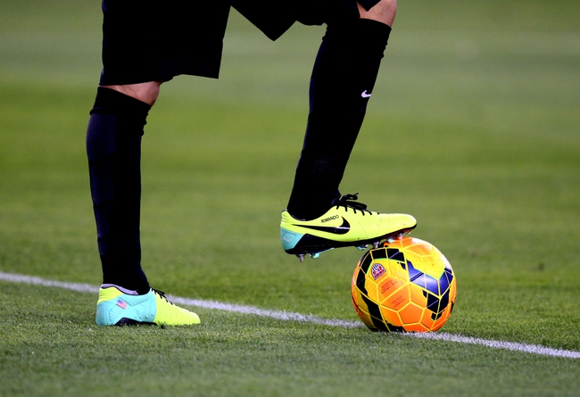 Apr 2, 2014; Glendale, AZ, USA; Detailed view of the Nike shoes worn by USA goalie Nick Rimando as he stands on a soccer ball against Mexico during a friendly match at University of Phoenix Stadium. The game ended in a 2-2 tie. Mandatory Credit: Mark J. Rebilas-USA TODAY Sports