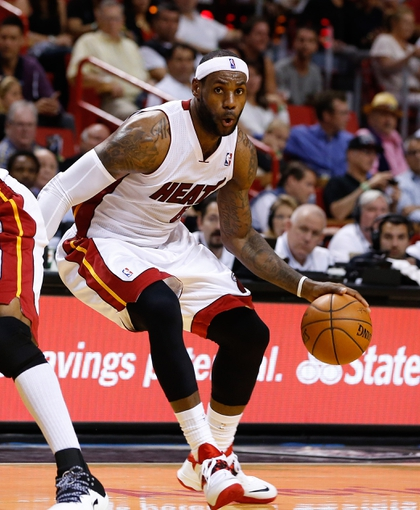 Mar 31, 2014; Miami, FL, USA; Miami Heat forward LeBron James (6) dribbles the ball in the second half of a game against the Toronto Raptors at American Airlines Arena. Mandatory Credit: Robert Mayer-USA TODAY Sports