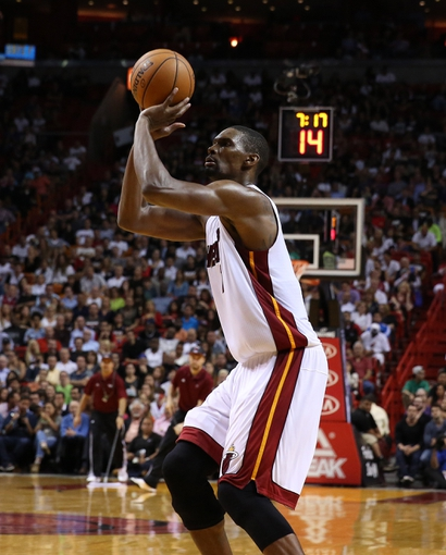 Mar 31, 2014; Miami, FL, USA; Miami Heat center Chris Bosh (1) shoots the ball in the second half of a game against the Toronto Raptors at American Airlines Arena. The Heat won 93-83. Mandatory Credit: Robert Mayer-USA TODAY Sports