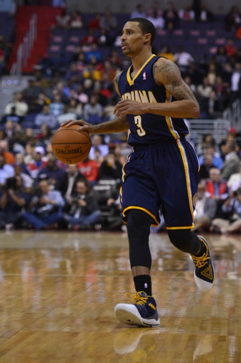 Mar 28, 2014; Washington, DC, USA;  Indiana Pacers guard George Hill (3) dribbles down the court during the first quarter against the Washington Wizards at Verizon Center. Washington Wizards defeated the Indiana Pacers 91-78. Mandatory Credit: Tommy Gilligan-USA TODAY Sports