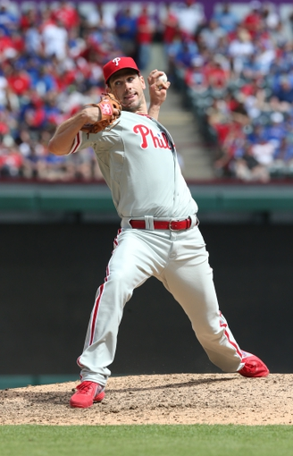 Mar 31, 2014; Arlington, TX, USA; Philadelphia Phillies starting pitcher Cliff Lee pitches in an opening day baseball game against the Texas Rangers at Global Life Park in Arlington. Mandatory Credit: Matthew Emmons-USA TODAY Sports