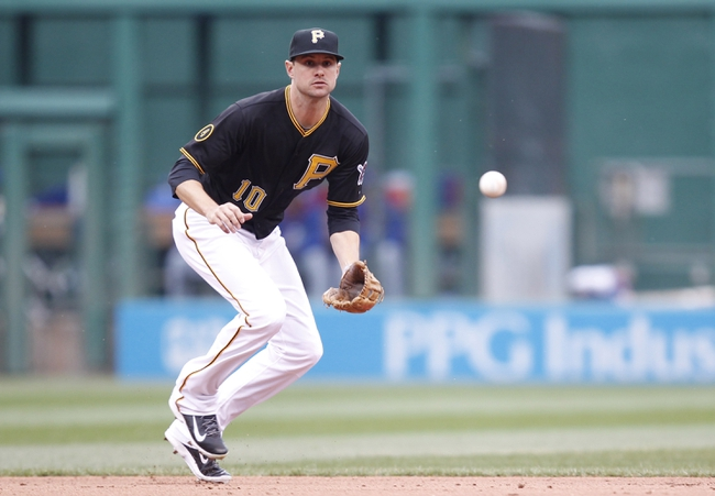 Apr 3, 2014; Pittsburgh, PA, USA; Pittsburgh Pirates shortstop Jordy Mercer (10) fields a ground ball against the Chicago Cubs during the seventh inning at PNC Park. The Cubs won 3-2. Mandatory Credit: Charles LeClaire-USA TODAY Sports