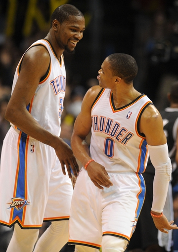 Apr 3, 2014; Oklahoma City, OK, USA; Oklahoma City Thunder forward Kevin Durant (35) and Oklahoma City Thunder guard Russell Westbrook (0) celebrate after a play in action against the San Antonio Spurs during the fourth quarter at Chesapeake Energy Arena. Mandatory Credit: Mark D. Smith-USA TODAY Sports