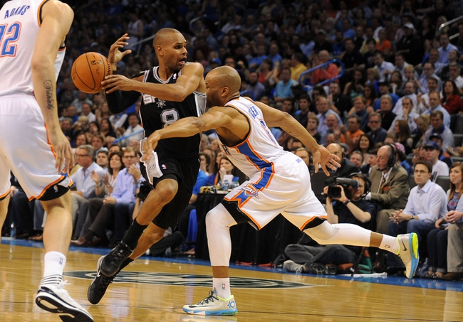 Apr 3, 2014; Oklahoma City, OK, USA; Oklahoma City Thunder guard Derek Fisher (6) attempts to steal the ball from San Antonio Spurs guard Patty Mills (8) during the third quarter at Chesapeake Energy Arena. Mandatory Credit: Mark D. Smith-USA TODAY Sports