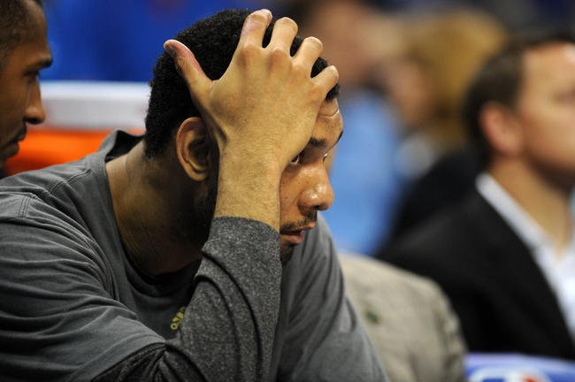 Apr 3, 2014; Oklahoma City, OK, USA; San Antonio Spurs forward Tim Duncan (21) reacts to a play in action against the Oklahoma City Thunder during the fourth quarter at Chesapeake Energy Arena. Mandatory Credit: Mark D. Smith-USA TODAY Sports