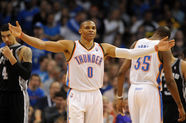 Apr 3, 2014; Oklahoma City, OK, USA; Oklahoma City Thunder guard Russell Westbrook (0) reacts after a play in action against the San Antonio Spurs during the fourth quarter at Chesapeake Energy Arena. Mandatory Credit: Mark D. Smith-USA TODAY Sports
