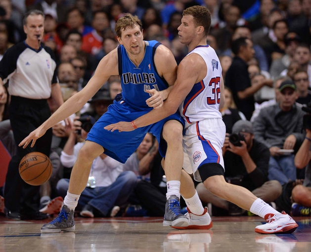 Apr 3, 2014; Los Angeles, CA, USA; Los Angeles Clippers forward Blake Griffin (32) guards Dallas Mavericks forward Dirk Nowitzki (41) during the first half of the game at Staples Center. Mandatory Credit: Jayne Kamin-Oncea-USA TODAY Sports