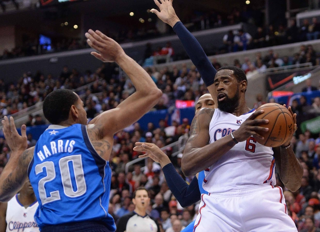 Apr 3, 2014; Los Angeles, CA, USA;   Los Angeles Clippers center DeAndre Jordan (6) grabs a rebound in front of Dallas Mavericks guard Devin Harris (20) during the first half of the game at Staples Center. Mandatory Credit: Jayne Kamin-Oncea-USA TODAY Sports