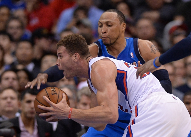 Apr 3, 2014; Los Angeles, CA, USA;   Dallas Mavericks forward Shawn Marion (0) guards Los Angeles Clippers forward Blake Griffin (32) during the second half of the game at Staples Center. Mavericks won 113-107. Mandatory Credit: Jayne Kamin-Oncea-USA TODAY Sports