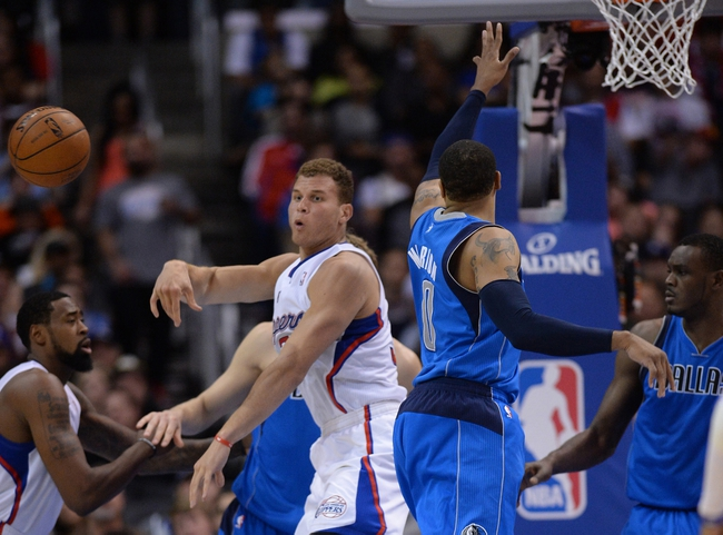 Apr 3, 2014; Los Angeles, CA, USA;   Los Angeles Clippers forward Blake Griffin (32) grabs a rebound from Dallas Mavericks forward Shawn Marion (0) during the second half of the game at Staples Center. Mavericks won 113-107. Mandatory Credit: Jayne Kamin-Oncea-USA TODAY Sports